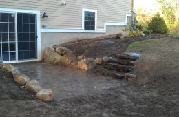 Patio with natural steps and rock wall – Dracut
